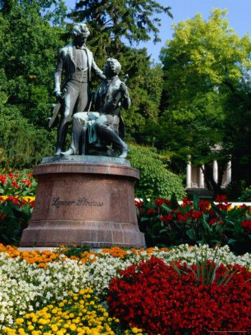 Monument in Kurpark with Mozart Temple in background, Baden, Austria ...