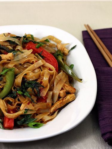 Drunken noodles (pad kee mao)- added bean sprouts and a splash of rice vinegar. Had to make due with linguine noodles and wedged yellow onion, but it was still delicious! Plenty of thai basil is key.