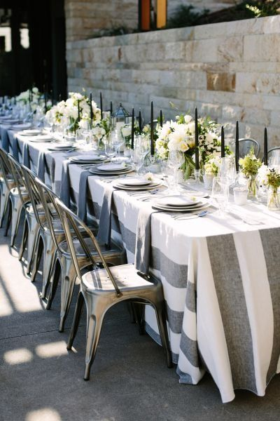 Industrial + preppy wedding reception decor - long, rectangle tables with gray + white stripe table linens, greenery + floral centerpieces and metal chairs {Megan Clouse Photography}
