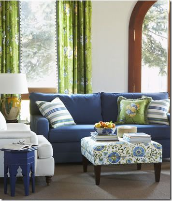 blue sofa, green curtains, & patterned ottoman with fabric by calico corner