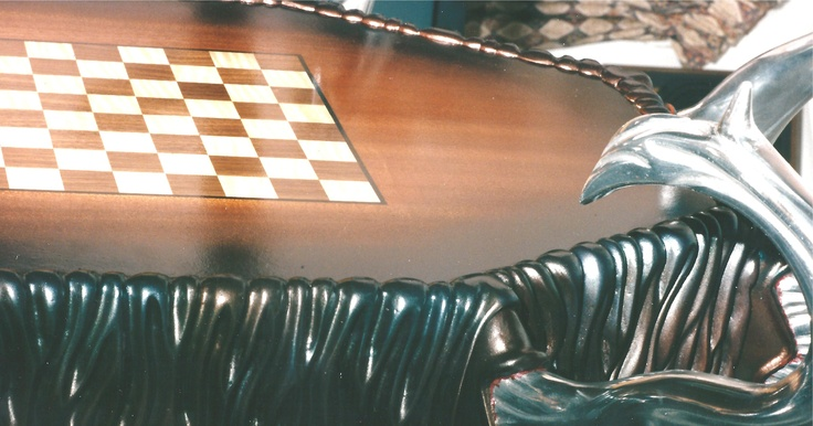 Enigma, was not only a coffee table, but flipped over to become a chess table. With the glass put back - you could again use it for a coffee table - with the parts and pieces still in place. A very unique conversation piece of furniture art. Check us out !