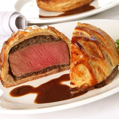 Beef tenderloin in puff pastry drizzled with red wine-gorgonzola sauce