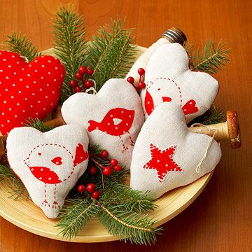 Heartfelt Ornaments  Spread your love this holiday season with heart shapes that brighten a bowl, your tree, or gift packages. Iron-on fabric scraps and a few embroidery stitches make the designs easy to craft in multiples.