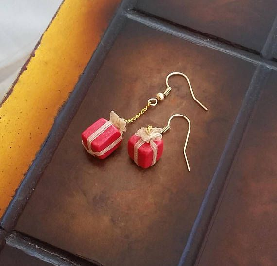 Red gift box miniature earrings decorated with golden ribbon