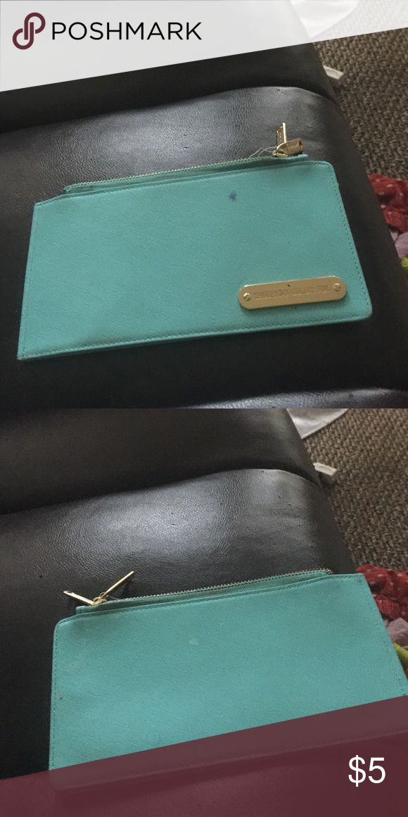 A cute skinny wallet! A cute skinny teal wallet! One of my favorites has flaws but still in good shape! Bags Wallets