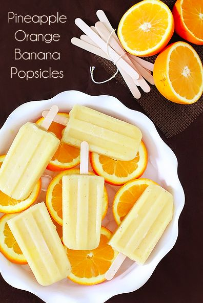 Pineapple Orange Banana Popsicles ~Made of nothing but fruit, you don't have to feel an ounce of guilt eating these yummy Summer treats. You could even let the kids have them for/with breakfast! Or break them out for dessert and they will never miss the extra sugar.