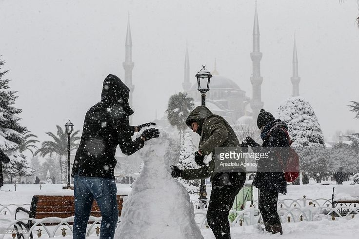 People make a snowman at snow covered Sultanahmet Square in Istanbul, Turkey on during snowfall on December 31, 2015.
