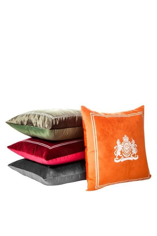 """In deep red, soft gray, gray-olive green and orange, and in a high quality velvet fabric having the Hotel Grande Bretagne's logo, the hotel's collection velvet pillow is a """"must"""" for every room."""