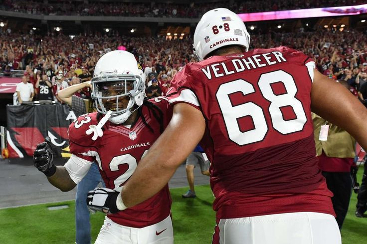 GLENDALE, AZ - OCTOBER 26: Running back Chris Johnson #23 of the Arizona Cardinals is congratulated by teammate offensive tackle Jared Veldheer #68 after running in a 26 yard touchdown against the Baltimore Ravens in the first quarter of the NFL game at University of Phoenix Stadium on October 26, 2015 in Glendale, Arizona. (Photo by Norm Hall/Getty Images)