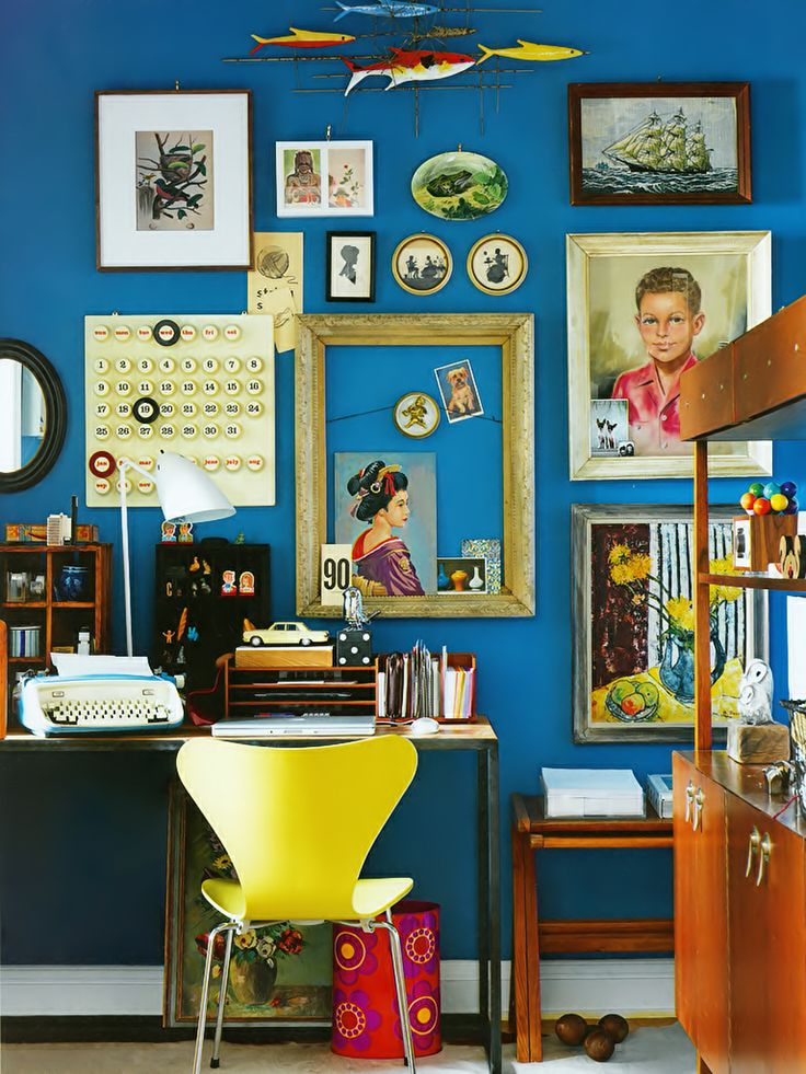 A beautiful wall color paired with eclectic art