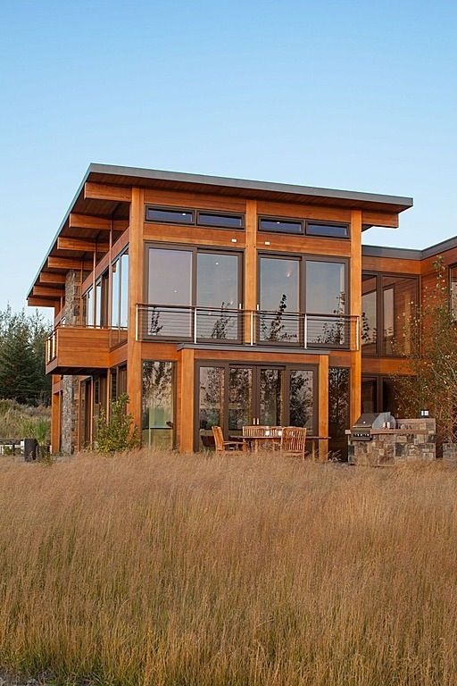 Exterior large windows shed roof warm wood feels like Contemporary prairie style house plans