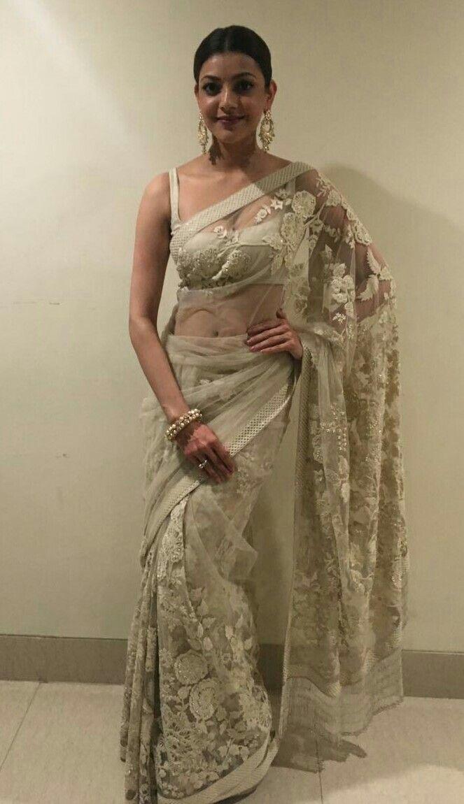 Kajal beautiful navel treat in transparent Saree