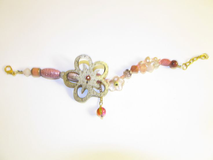 Handmade laser cut leather bracelet (1 pc)  Made with gold/copper leather flower, glass beads and details of freshwater pearls.