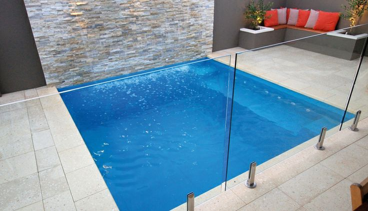 I like the water wall, the muted colours of the surrounds (use of texture) and the clear glass pool fence.