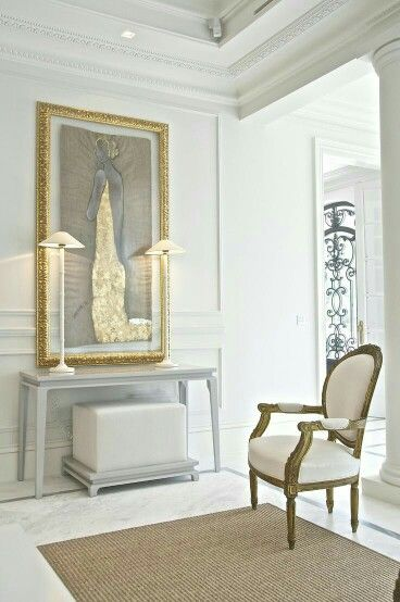 A pure white theme with white chair of classic period  .