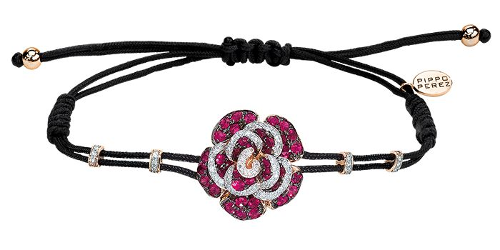 Cellini Jewelers 18 karat rose gold and ruby rose. Pippo Perez