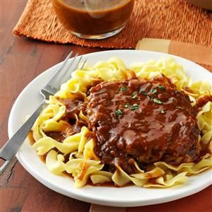 Salisbury Steak with Onion Gravy Recipe -This hearty main dish is a favorite at our house. It really warms you up. —Kim Kidd, New Freedom, Pennsylvania