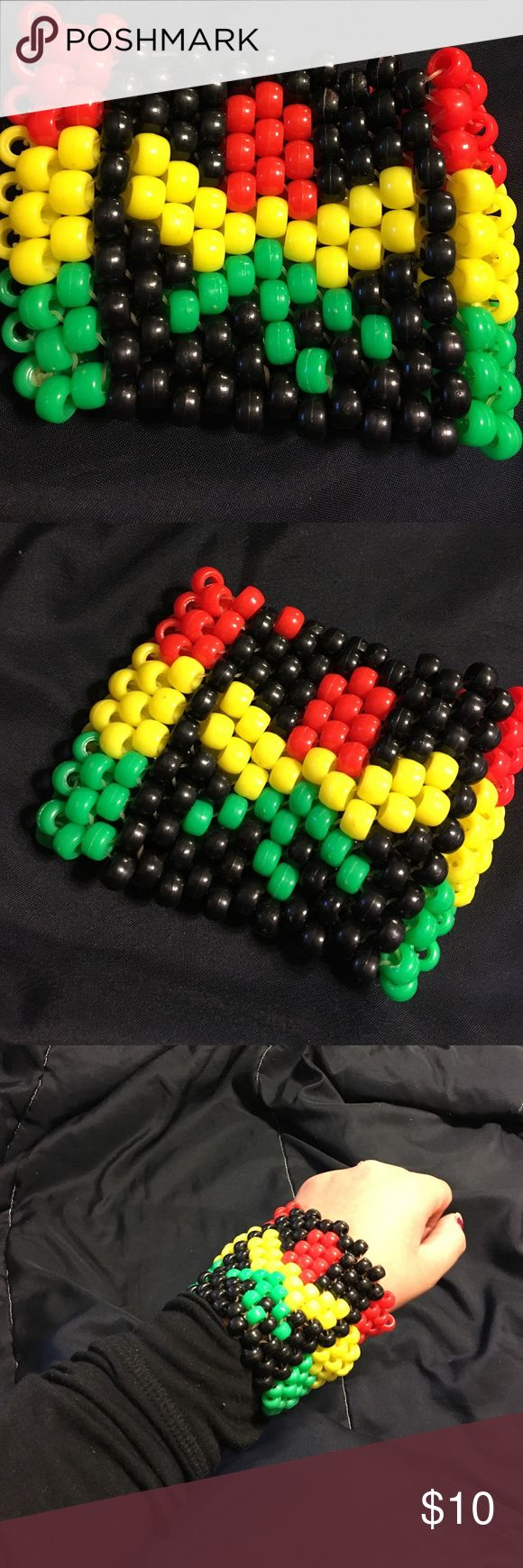 Kandi cuff Rasta ganja cuff, since this was my first cuff it does have a bead in the wrong color (seen in second picture) Jewelry Bracelets