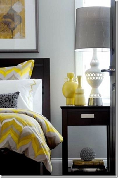 Pops of yellow mixed with white and grey create a stylish bedroom! Designer tip: repeating your accent color three times in a room provides balance.