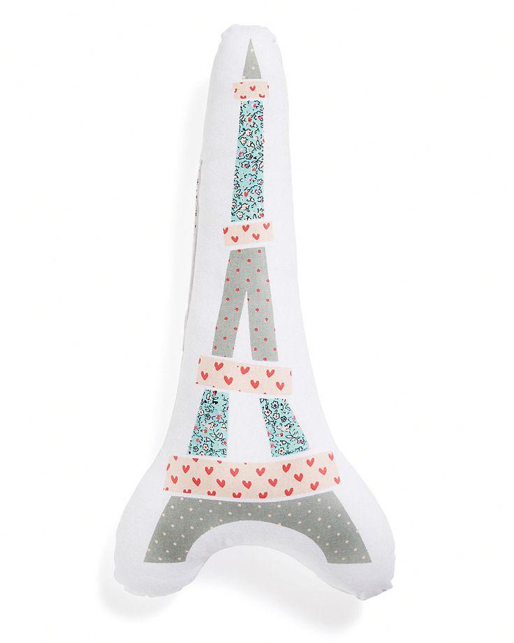 Mønstret pute i form av Eiffeltårnet på hvit bakgrunn. Ren bomull. Fyll i 100% polyester (330 g/m²).