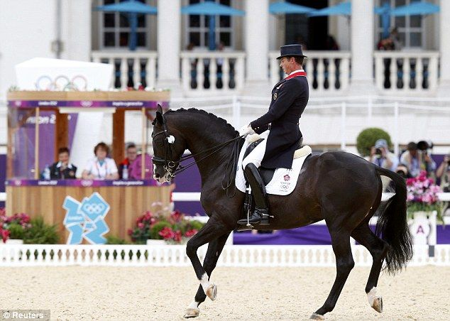 Britain's Carl Hester, pictured riding Uthopia to a first gold medal in the team dressage competition - it is the first time ever that Britain has won gold in an Olympic dressage competition and means that Team GB has 20 gold medals and is now the most successful since 1908