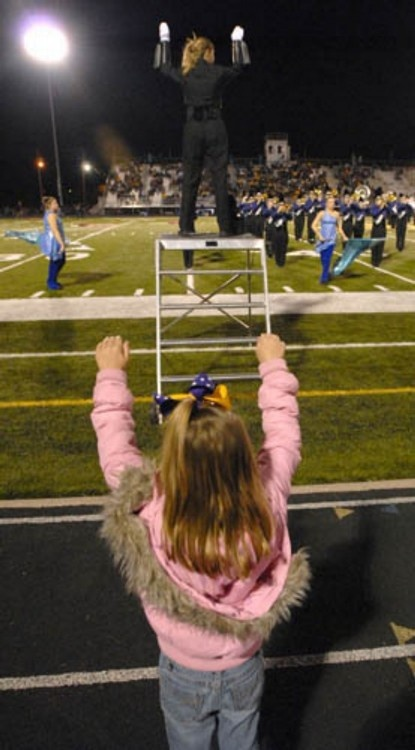 this reminds me of my band directors daughters. they both have daughters and they like to imitate the drum major or dance to what we play lol :)