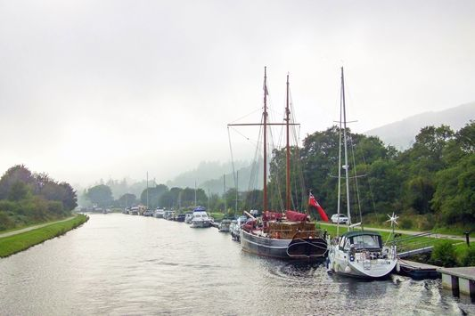 SAILING LOCH NESS AND THE CALEDONIAN CANAL - SCOTLAND. Exploring the Scottish Highlands: a travel diary of Inverness, Scotland and our favorites stops at Loch Ness, Urquhart Castle and the Jacobite Passion Tour. #scotland #highlands #scottishhighlands #inverness #jacobitepassiontour #jacobitetours #scotlandtravel #visitscotland #dallasdhudistillery #dallasdhu #urquhartcastle #lochness #corrimonycairns