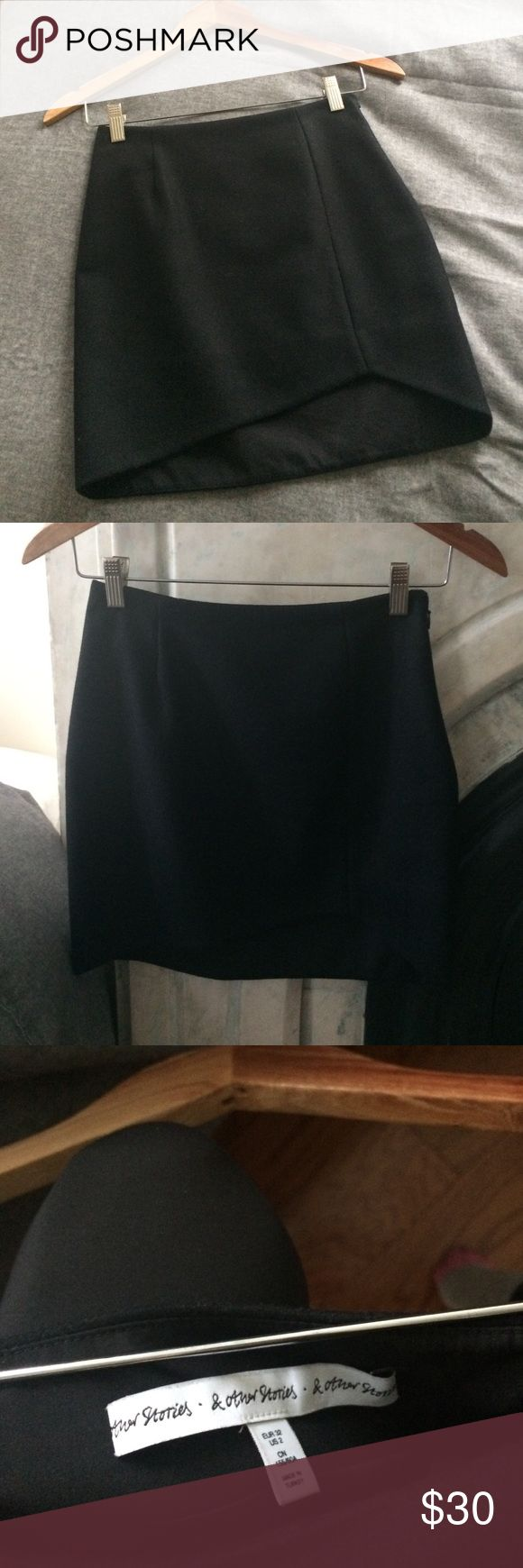 & Other Stories black mini skirt Black mini in wool blend type material with smooth lining. Slightly higher hem in the front left and longer in back. Super cute, great condition. & other stories Skirts Mini