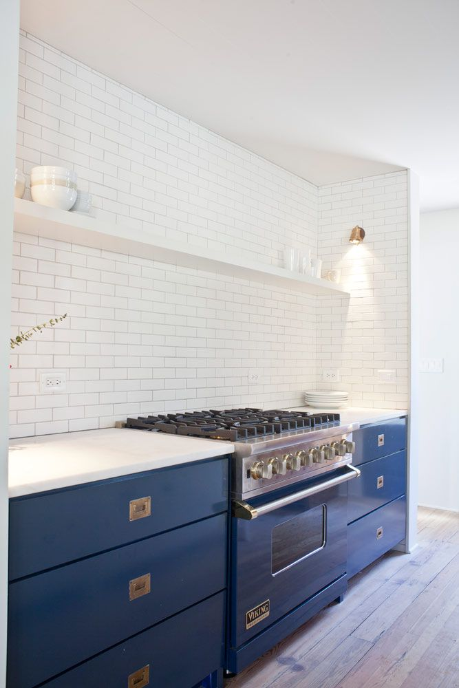 Blue cabs with brass campaign hardware, white open shelving above/ no uppers  [Jen Langston Interiors]