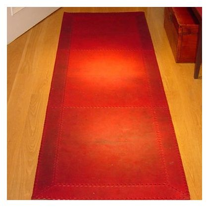 Leather mat by Bill Amberg Studio.