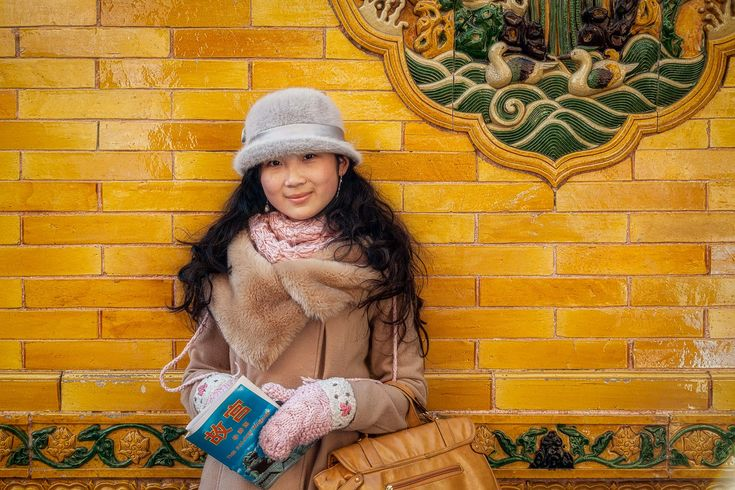 A portrait of a beautiful young woman in the Forbidden City in Beijing, China.