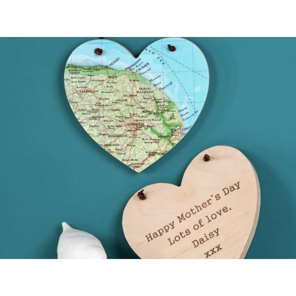 A wooden hanging heart, personalised with your choice of map location and personalised message on the back. A unique gift for Mother's Day.