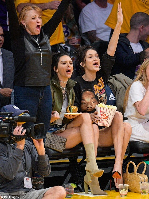 Victoria's Secret models Kendall Jenner and Bella Hadid were for once taking a backseat on Tuesday night, as they watched on at the Los Angeles Lakers game at the Staples Center.
