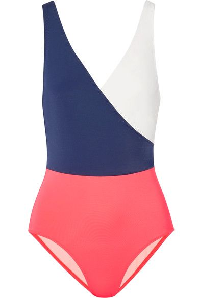 "Solid & Striped creates ""effortless essentials for the leisurely life."" This 'The Ballerina' full-coverage swimsuit is cut from pink, navy and white stretch-jersey. It has a wrap-effect V-neckline that will flatter your décolletage and is fully lined for optimum opacity. Wear it poolside with a sunhat."