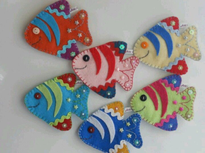 Felt fish. INSPIRATION ONLY! But all you need to do is draw the shape,  Cut 2, add a little stuffing, blanket stitch the edges. Then embellish Like the image, or totally go out on your own! SOME MANY USES YEAR 'REOUND!