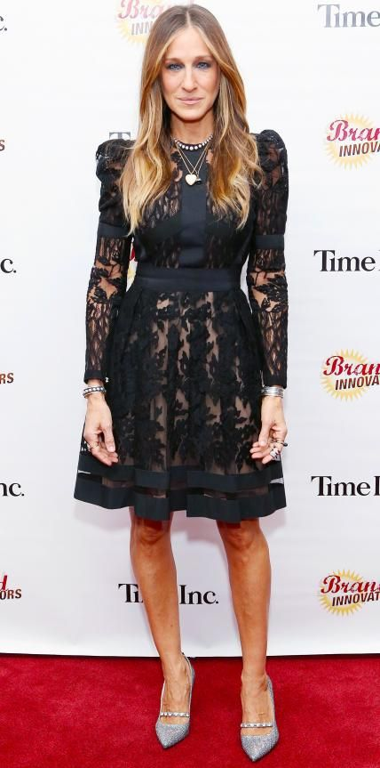 Sarah Jessica Parker dialed up the drama in a black sheer lace fit-and-flared frock, complete with her usual eclectic mix of jewelry and shimmery pumps from her SJP collection.