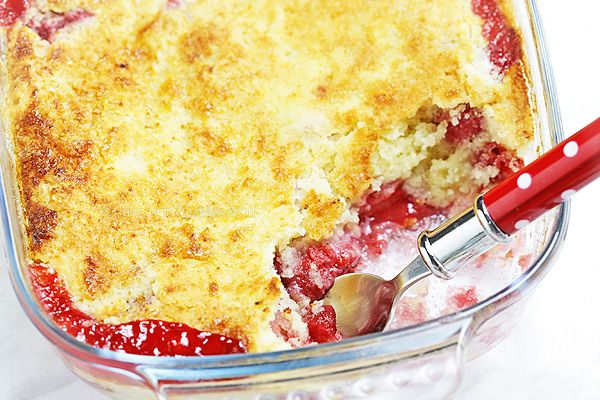 Strawberry Dump Cake - probably the easiest cake ever! Fresh strawberries, cake mix and butter dumped in a cake pan, baked and served with vanilla ice cream. Yum!