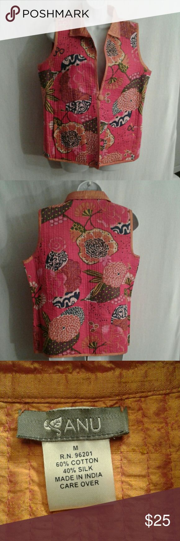 Anu quilted tropical sleeveless vest sz M This is a cotton vest lined and trimmed in silk. It has a single, silk- covered, front button closure. The vivid floral print is in shades of hot pink, orange, purple, green, and yellow. The vertical quilting is very figure- flattering. Anu Jackets & Coats Vests