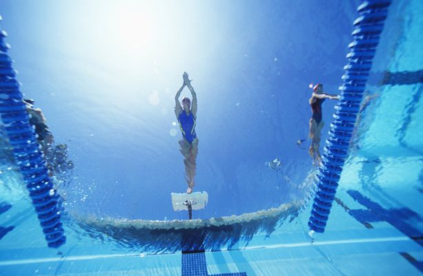 View of female swimmer diving Nine Best Exercises for Weight Loss