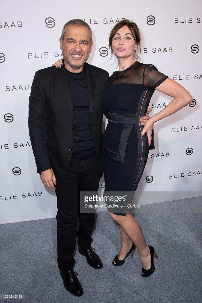 Photo d'actualité : Elie Saab and Emmanuelle Beart pose backstage...