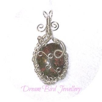 Designed and hand crafted by Dream Bird Jewellery this sterling silver pendant features a piece of Unakite. This piece has been intricately wireworked around the sides as well as the decoration on ...