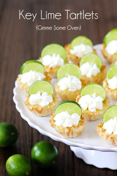 Key Lime Tartlets {Gimme Some Oven}.  These would be awesome topped with a raspberry too!  Tartlets.. hehehe.. tartlets..