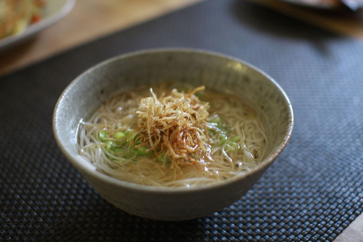 A recipe to make nyumen, a hot soup that is made with Japanese Somen noodles, vegetables and meats.