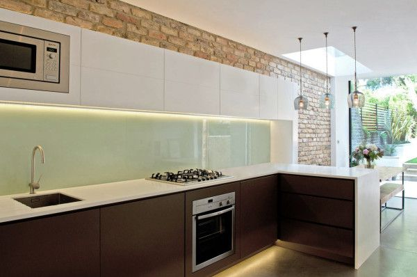 Natural light brings out the beauty of this brick wall // Leamington Road Villas by Studio 1 Architects