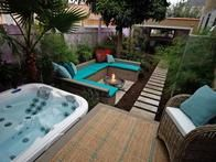 Jamie completely revamps the yard, giving it a fresh new look and feel with a hot tub, wicker outdoor furniture, lounge seating and a fire pit.