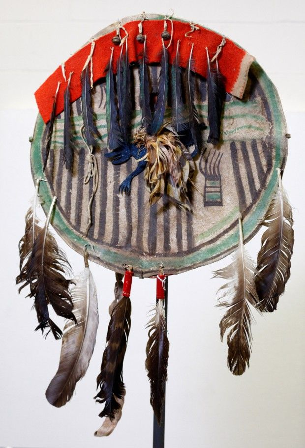 A Crow shield featuring eagle feathers and a painted bear claw from the Dyck collection at the Plains Indian Museum in Cody, WY