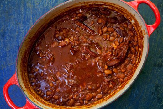 Slow-cooked cowboy beans with pinto beans, ham hocks, barbecue sauce, and coffee. Great accompaniment to a summer barbecue.