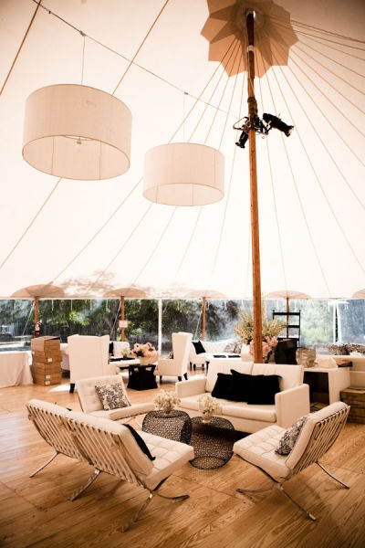 sperry tent with drum lights over the lounge area