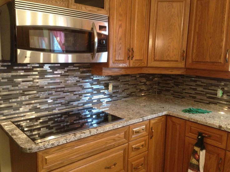 Giallo Ornamental Granite With A Mosaic Backsplash