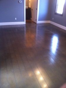 Stained concrete -Looks like wood. I've seen this in a home before and was amazed to find out it was concrete.